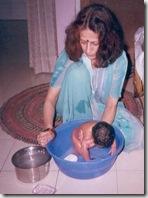 Nani_giving_bath_to_her_dohti